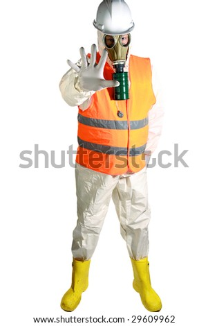 a man in a white hazmat suit, orange safety vest, and hard hat, and a gasmask holds his hand out to stop traffic representing the current Mexican Swine Flu Pandemic - stock photo