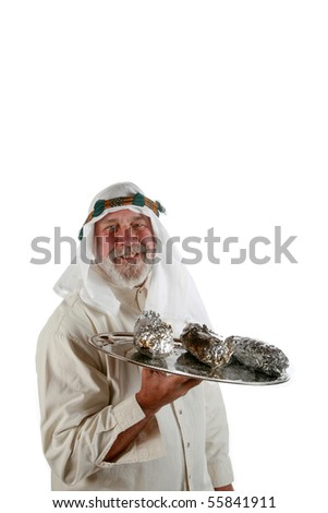 a man in an middle eastern waiter costume makes a funny face as he brings hot food on a silver platter isolated on white - stock photo