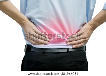 A man in blue shirt feeling pain on his back - stock photo