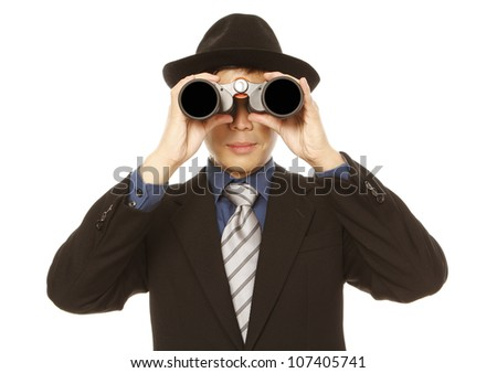 A man in business attire and hat using binoculars (on white) - stock photo