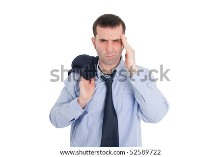 A man in business clothes looking tired (jacket over his shoulder, loosened necktie, wrinkled shirt, slightly unshaven)  - maybe he's had a hard day at the office, a headache, a hangover, etc. - stock photo
