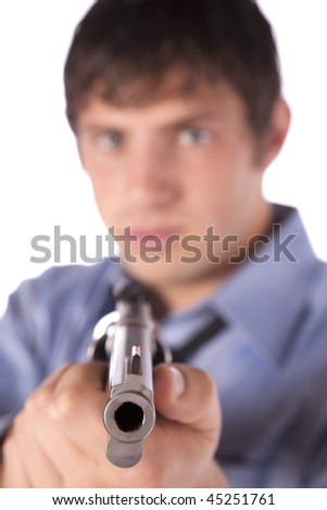 A man in business clothes with an angry expression on his face holding a pistol. - stock photo
