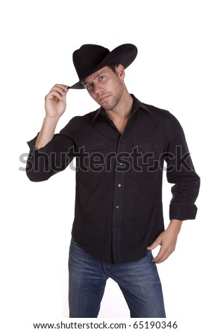 a man in his black cowboy hat tiping it with his fingers saying hello. - stock photo