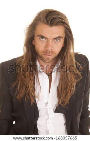 A man in his formal attire looking at the camera. - stock photo