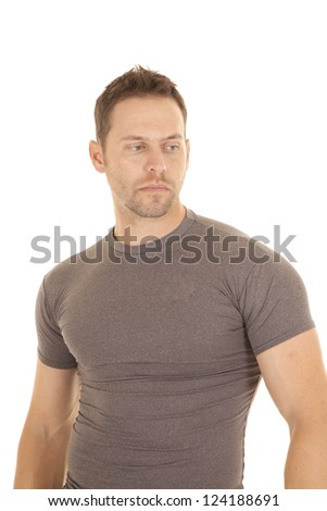 A man in his gray tight fitted shirt with a serious expression on his face. - stock photo
