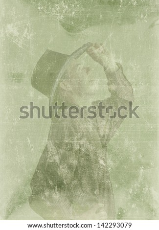 A man in his plaid shirt and black western hat with fun expression on his face. looking up on gray background  Filter old retro vintage filter - stock photo