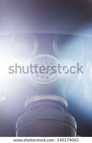 A man in military helmet and gas mask - stock photo