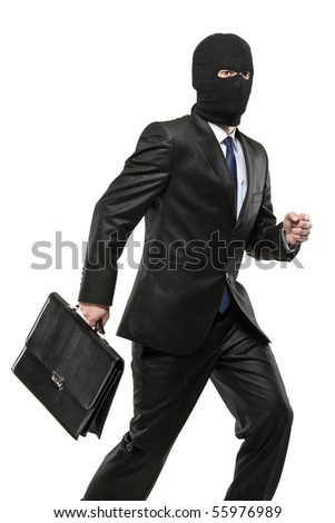 A man in robbery mask carrying a briefcase isolated on white background - stock photo