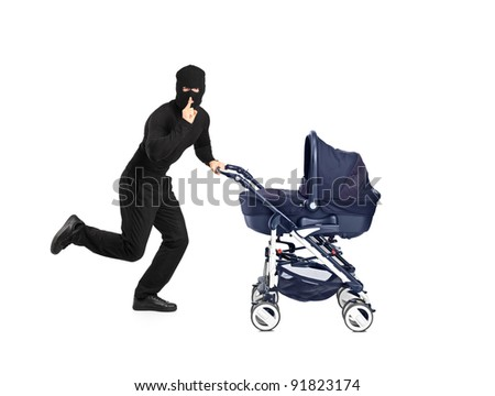 A man in robbery mask running and pushing a baby stroller with finger on the lips gesturing silence isolated on white background - stock photo