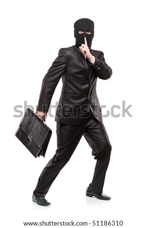 A man in robbery mask stealing a briefcase isolated on white background - stock photo