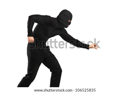 A man in robbery mask trying to steal something isolated on white background - stock photo