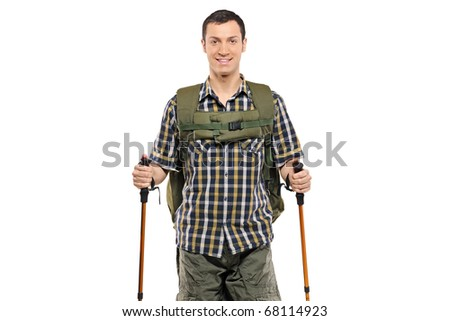 A man in sportswear with backpack and hiking poles isolated against white background - stock photo