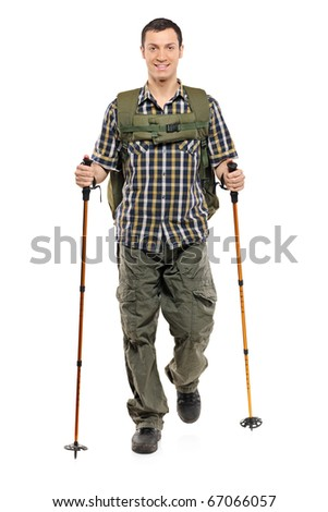A man in sportswear with backpack and hiking poles isolated on white background - stock photo