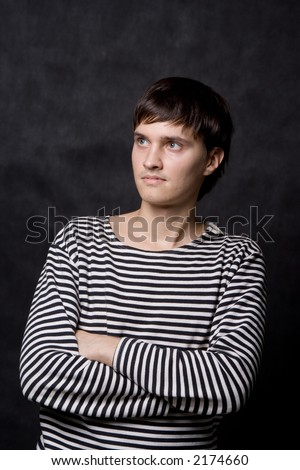 A man in striped vest, isolated on black - stock photo