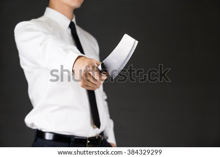 A man in white shirt  holding knife