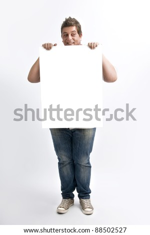 a man in white uniform holding a whiteboard in the studio - stock photo