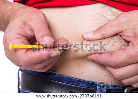 A man injects himself a drug in the belly - stock photo