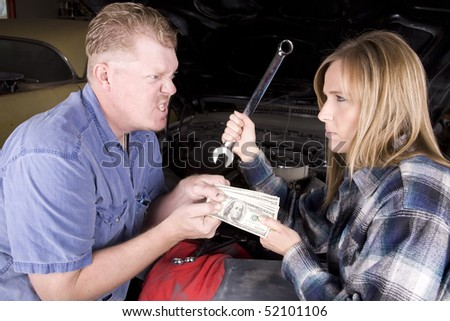 A man is angry with the mechanic and doesn't want to give her money, while she is holding a wrench with an angry expression on her face in front of a car engine.