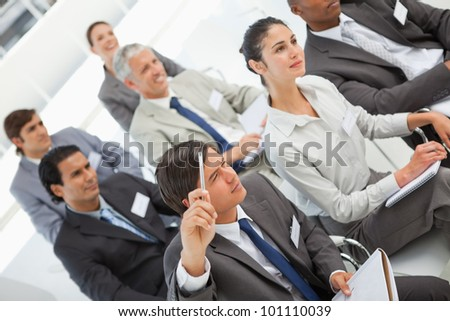 A man is asking a question at a business meeting - stock photo