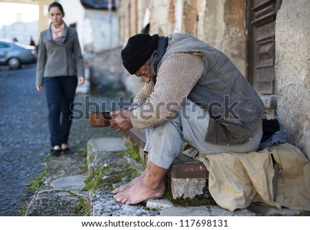 A man is begging on the street - stock photo