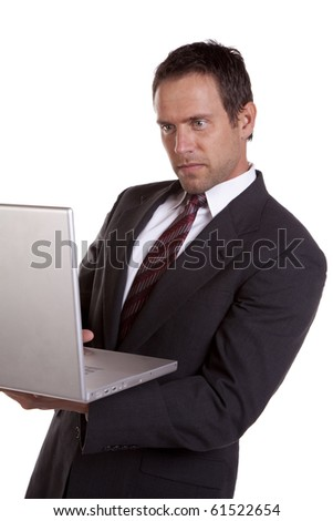 A man is concentrating on his laptop. - stock photo
