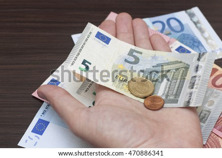 A man is counting cash money, euro currency