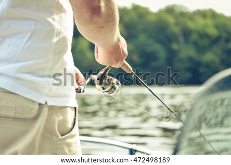 A man is doing fishing for relaxing in the leisure