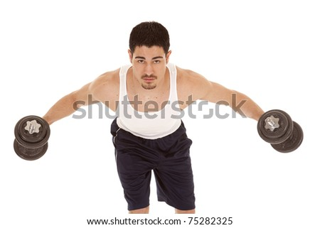 A man is holding weights with his arms out. - stock photo