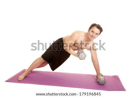 A man is on his side curling some weights. - stock photo