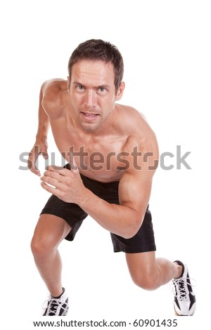 A man is running and smiling. - stock photo