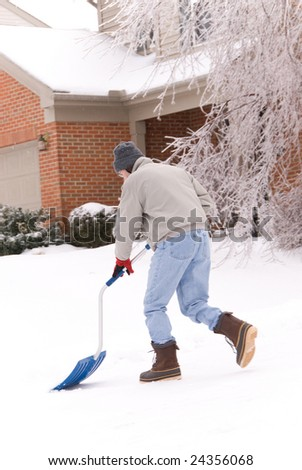 A man is shoveling snow during the winter snowstorm in Kentucky USA. - stock photo