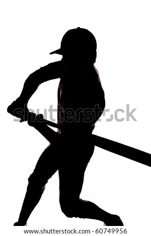 A man is silhouetted on a white background beginning to swing his bat - stock photo