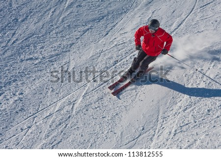 A man is skiing at a ski resort - stock photo