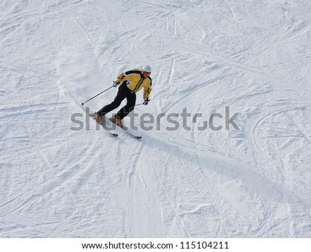 A man is skiing at a ski resort - stock photo
