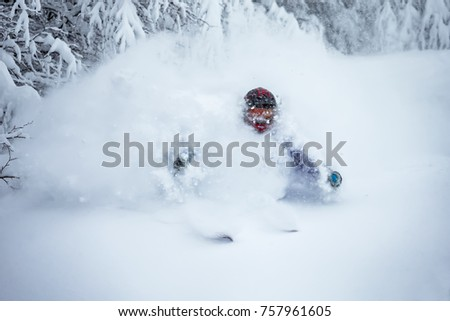 A man is skiing in the deep snow, off-piste skiing.