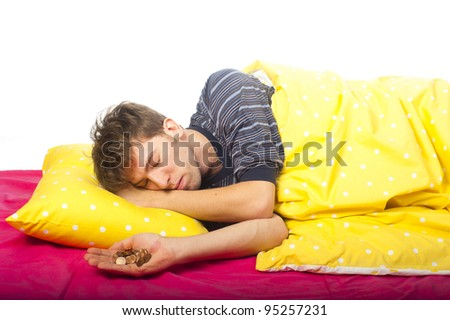 a man is sleeping with some coins in his hand - stock photo
