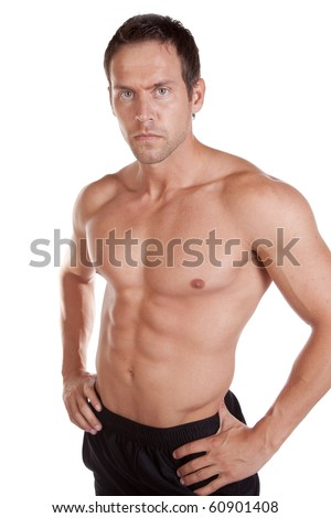 A man is standing with his shirt off and very strong muscles.