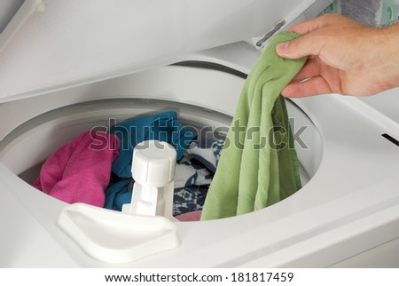 A man is taking out laundry after been washed - stock photo