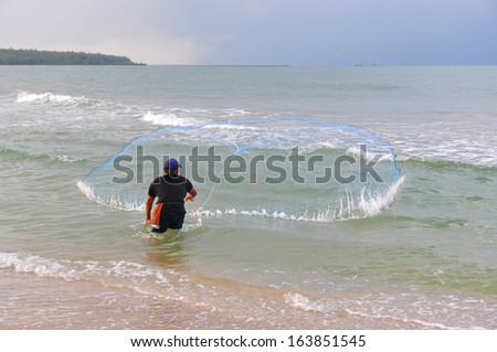 A man is throwing a fishing net