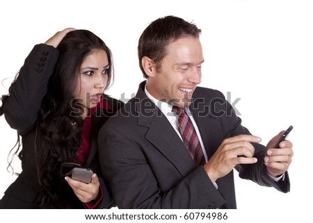 A man is very happy with a text he just got, but a woman is angry about it. - stock photo