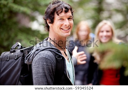 A man is waiting for a girl on an outdoor hike - stock photo