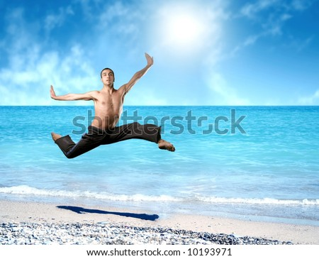 a man jump on the beach