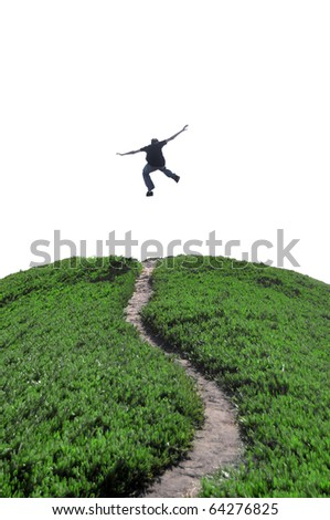 A man jumping above a narrow dirt pathway expressing his freedom. Isolated white blank copyspace above with room for your text. - stock photo