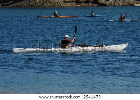 A man kayaking in the ocean. Shot in the cove of San Diego, California