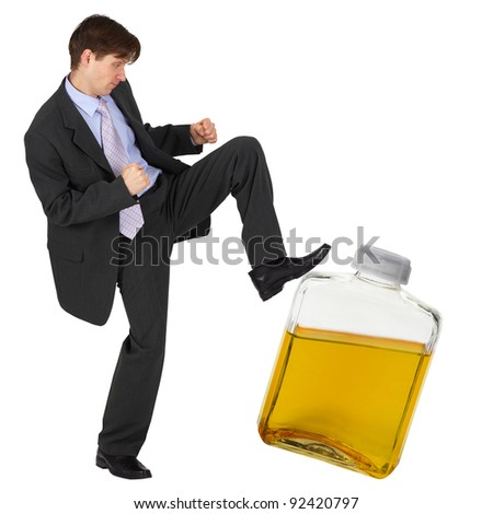 A man kicks a bottle of yellow liquid - stock photo