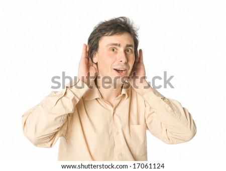 A man listening to something with a smile - stock photo