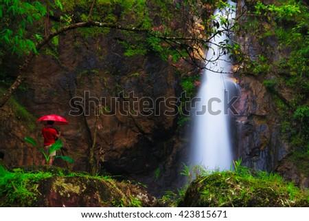 A man lives at Jogkradin waterfall in Thongphaphum nationalpark, Kanjanaburi province, Thailand - stock photo