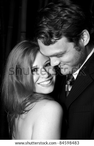 A man looking at woman, who is smiling - stock photo