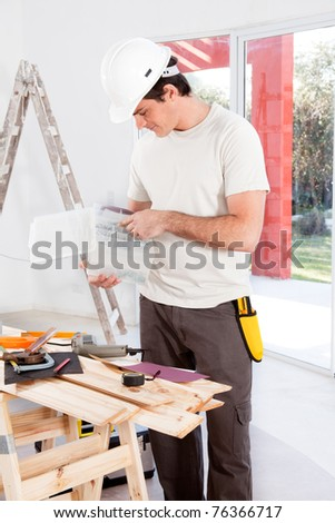 A man looking for a screw, doing home improvements - stock photo