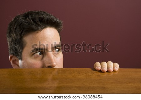 A man looks across into copyspace shocked! - stock photo